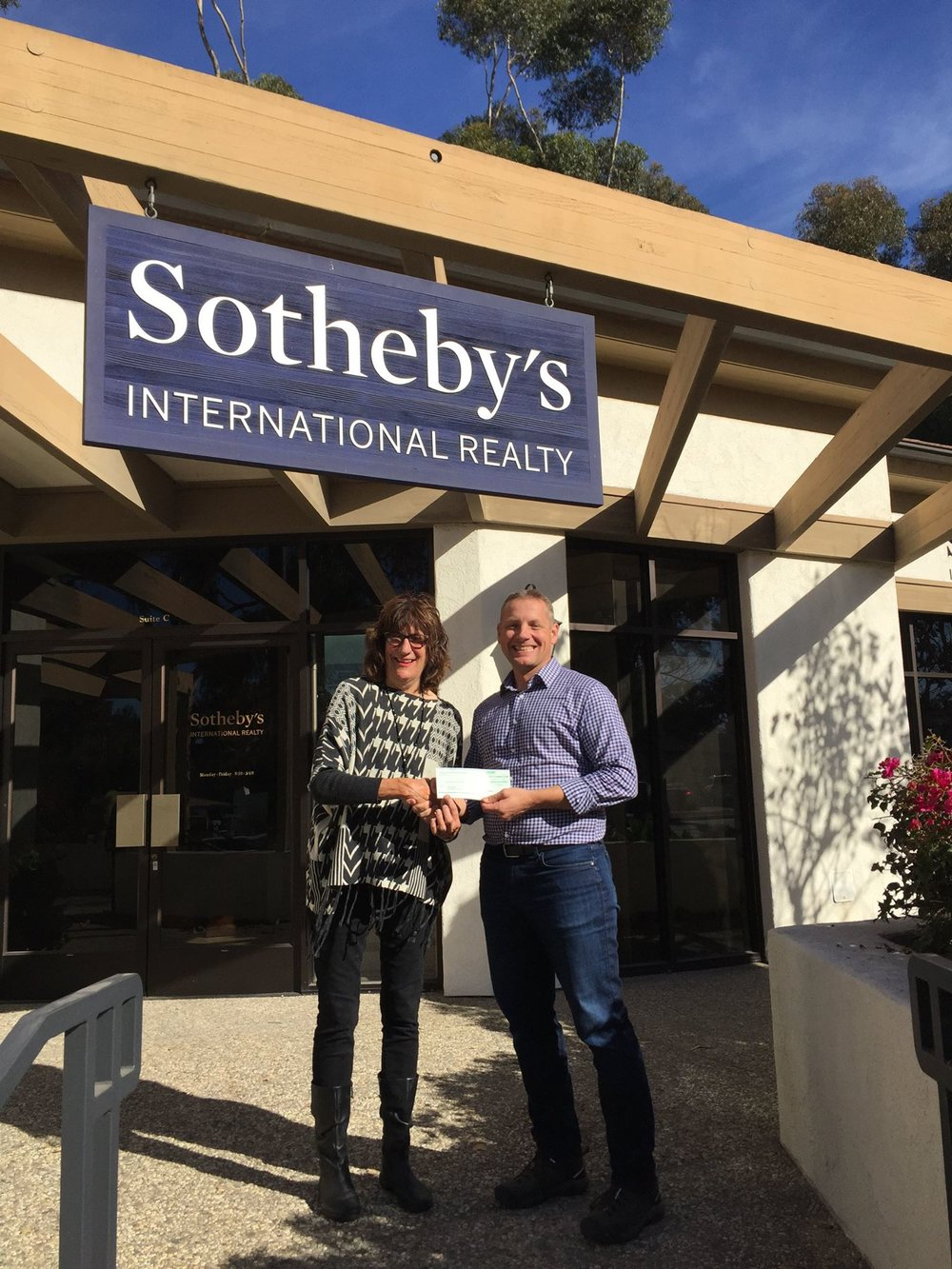 Hillary Hauser accepts donation from Sotheby's International Realty for 8th year in a row!   (Rich van Seenus of Sotheby's International Realty, Montecito office does the honors)