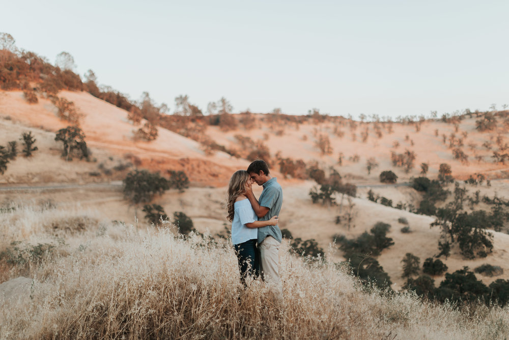 madi and caleb milerton lake fresno ca grass mountain couple love session