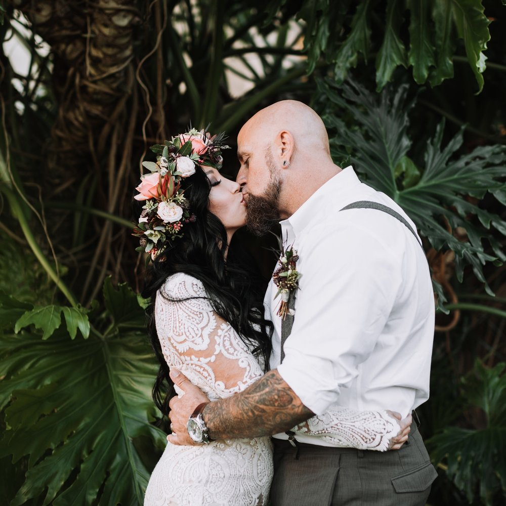 Stephanie and Neil elopement at the santa barbara courthouse with hawaiian tropical floral vibes