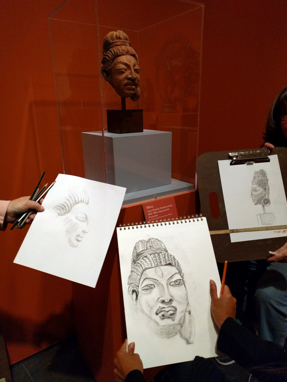 "Left to Right: Rosie McGraw, Sharmini Sarvananda, and Cindy Derzay drawing ""Head of Shiva"" from Northern India, 400s to 500s"