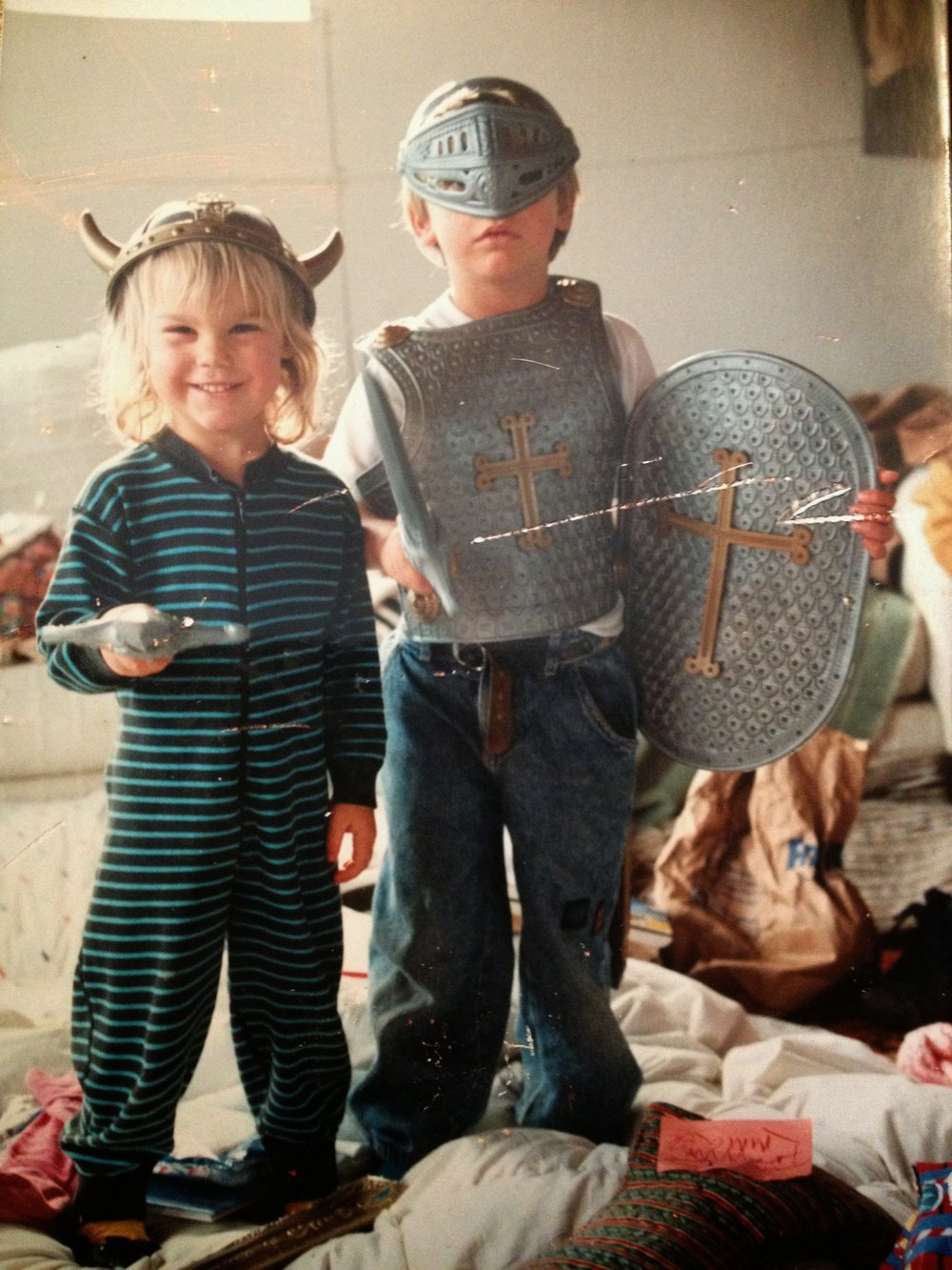 My story starts in the 90's (I'm the one with the sword). -  I'm a little girl, living in a cabin in the woods in Southern Oregon, and all I want is to be a writer…and to have a puppy. So I grow up and I go to school in Boston to become a writer. Then I realize writers don't make any money.I try to adjust to the writing lifestyle by eating lots of ramen and refried beans. I realize I hate ramen. And rent in Boston is expensive. So I get a real job. And I buy my first pair of work heels. They're shiny patent leather. Every morning, my heels go click-click-click down a big corporate hallway.