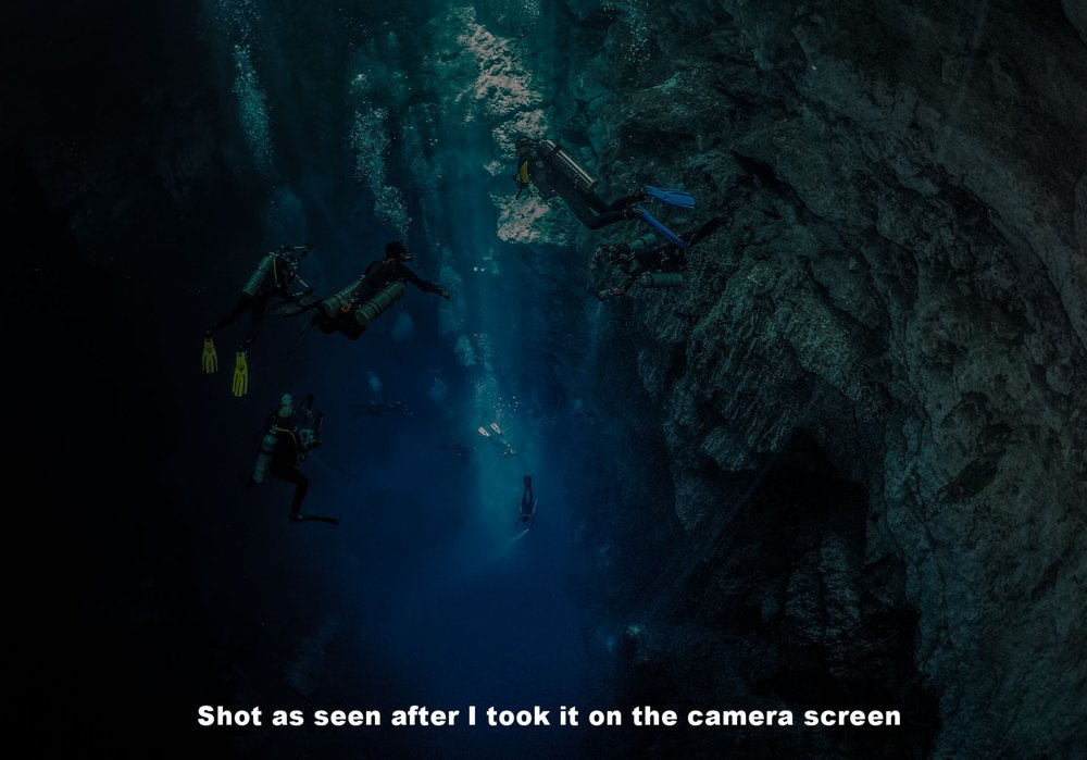 I wanted to get a shot showing the scale of the Pit, and the clarity of the water, with divers at different levels, but knew that the dynamic range would be a problem. And so I exposed the shot for the brightest part of the shot, which was the light patch of rock being struck by the sunlight at the top middle of the shot.