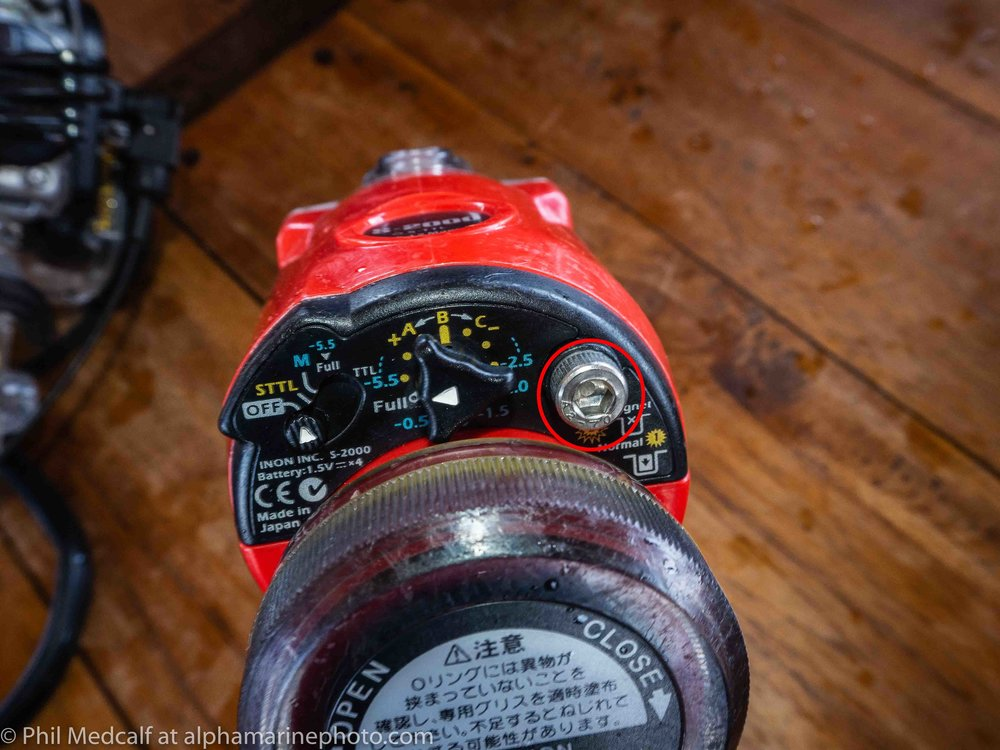 The screw circled in red is where the magnet is fitted to set the INON S2000 to work without preflash.