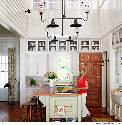 Pretty White Kitchen and Wood Fridge via southernliving.com