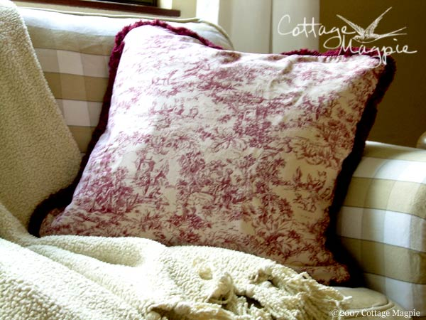 Red and cream toile pillow