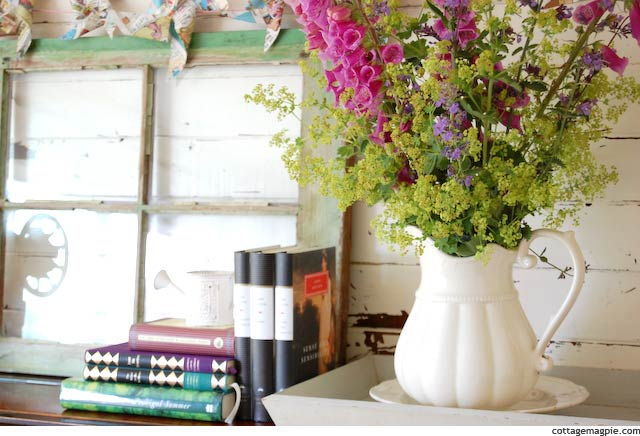 Flowers and Summer Reads on the Piano Mantel