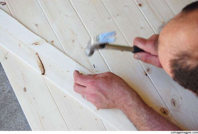 Scrap Paneling Strip as a Nailing Guide on the Faux Vintage Door