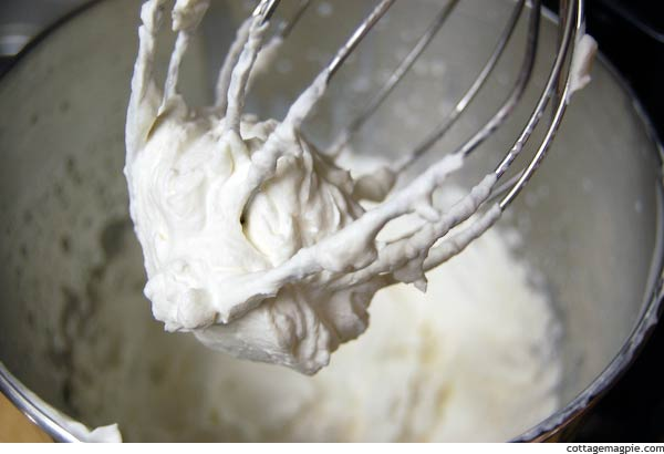Stand Mixer Whisk Covered in Whipped Cream