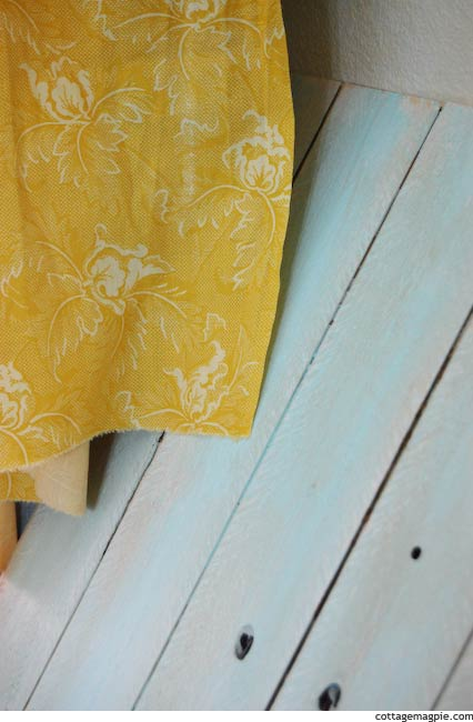 Closeup of Yellow Curtain Fabric and Aqua Paneling