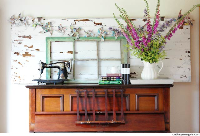 Faux Vintage Door on Piano as Mantel via cottagemagpie.com