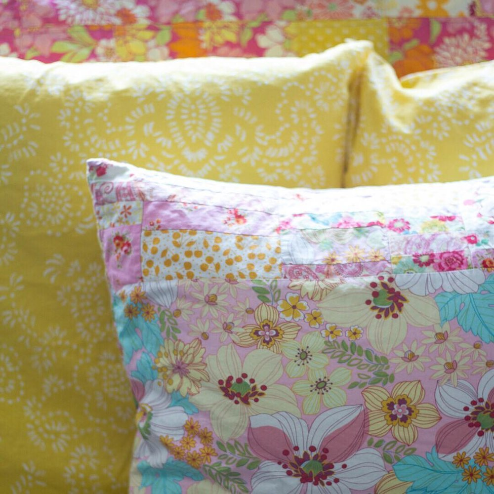 Pink Random Patchwork Pillow and Yellow IKEA Shams - via www.cottagemagpie.com