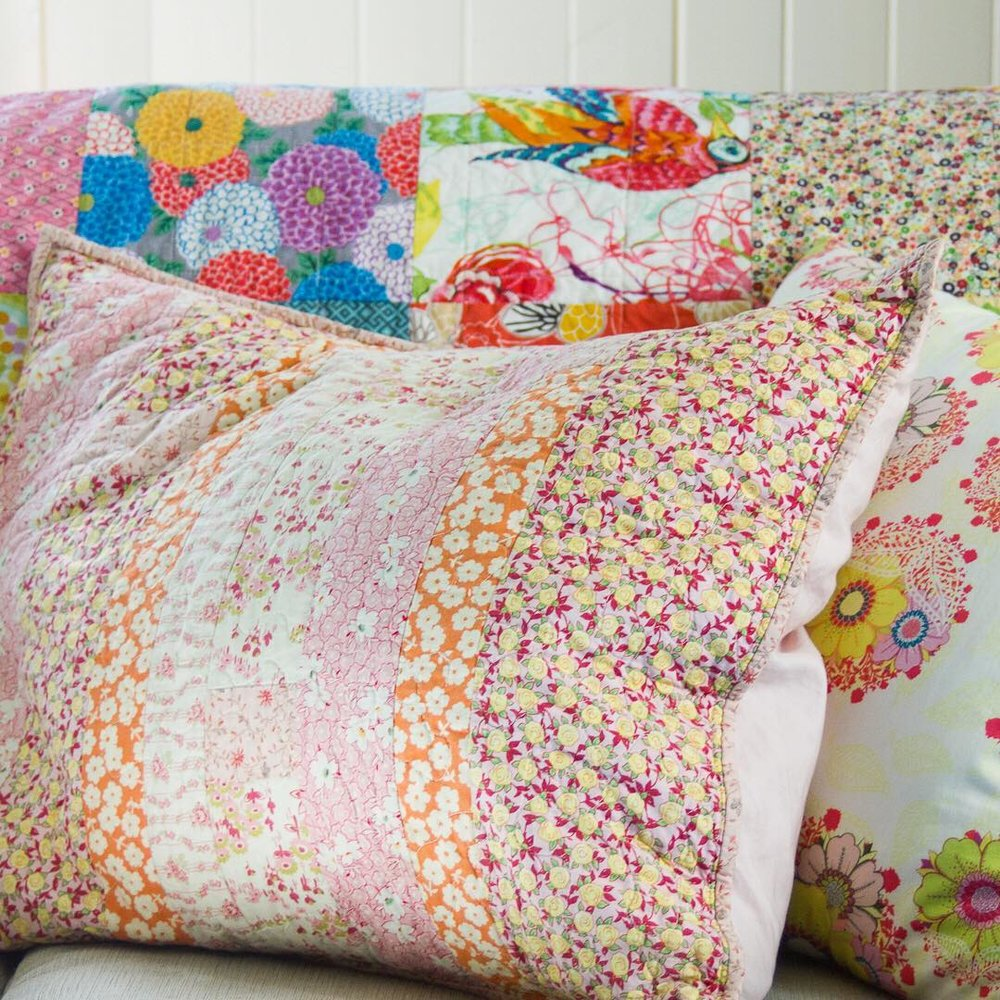 Pink Quilted Pillows and Boho Squares Quilt - via www.cottagemagpie.com