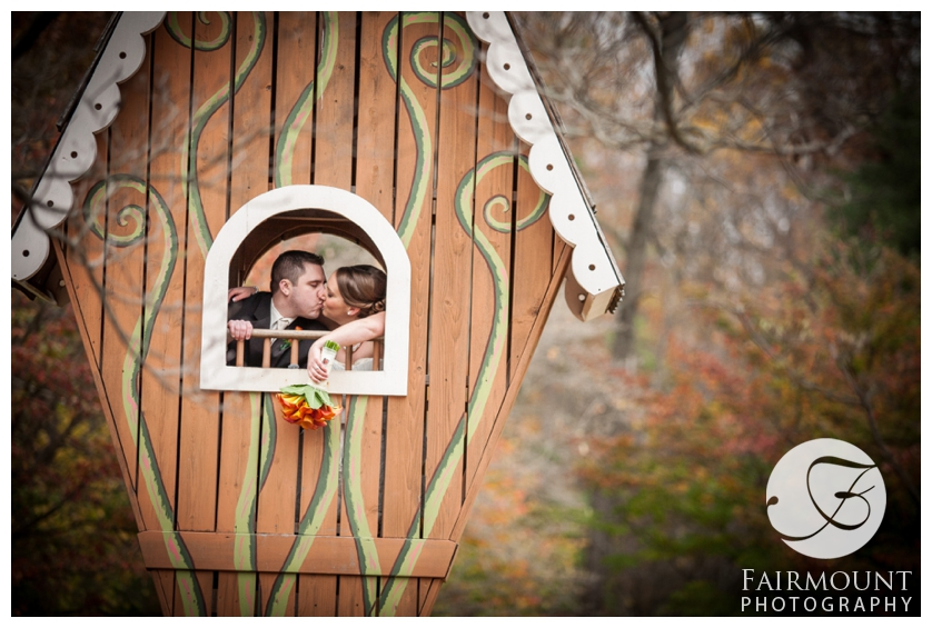 Bride and Groom kissing in a treehouse at Tyler Arboretum