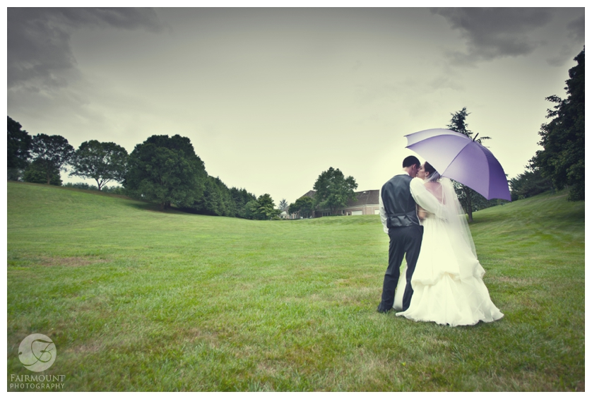 Bride and Groom Under Purple Umbrella
