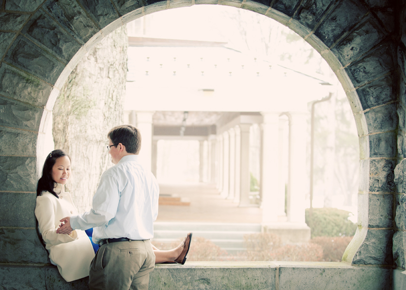 Couple holds hands in stone archway at Blair Academy in NJ