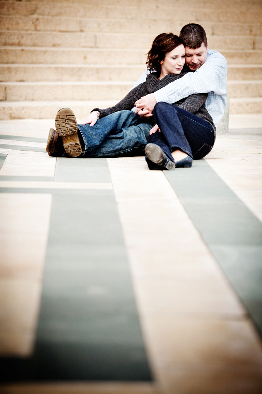 Stone pattern on ground frames cuddling couple at Philadelphia Museum of Art