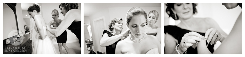 Bride gets help while getting ready