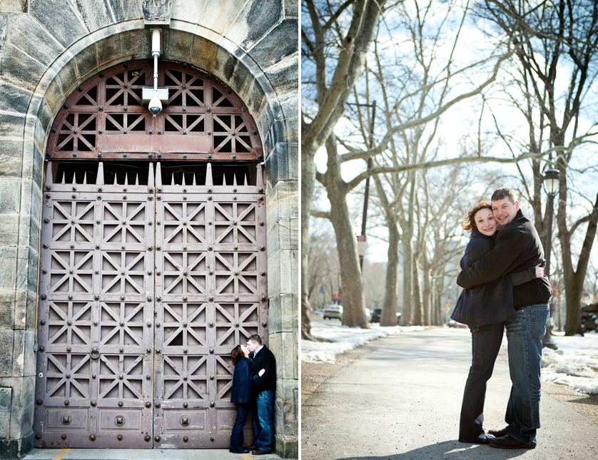 Cool cast iron door with stone arch frames kissing couple; cuddling on bike path behind art museum, Philadelphia, PA