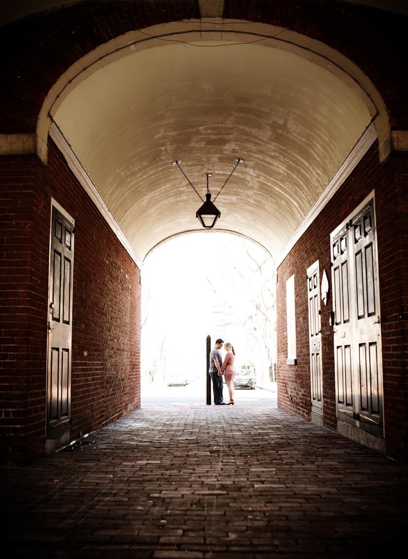 Engagement photo in empty headhouse market archway, Philadelphia, PA