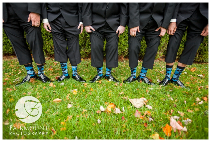 Groom and groomsmen show off their argyle socks