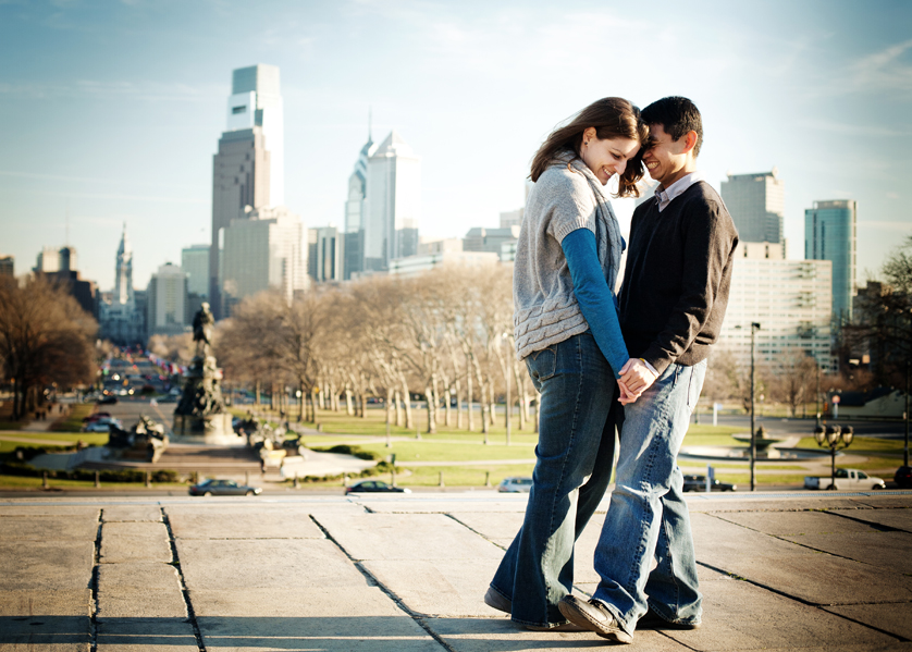 Couple standing at top of Art Museum steps with Philadelphia skyline