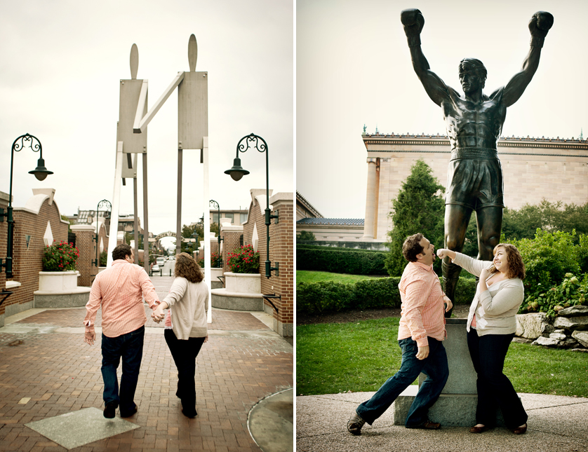 Couple mimicking South Street statue and mock knock-out in front of Rocky Statue in Philadelphia, PA