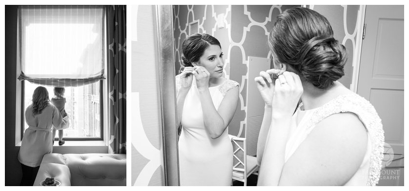 Bride looking in mirror. Bride putting earrings on in mirror.