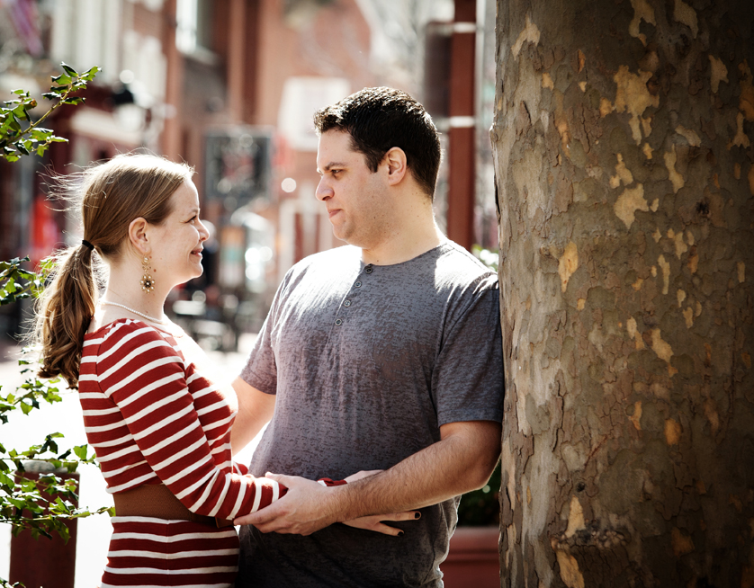 Couple looks at each other in busy South Philly square near South Street