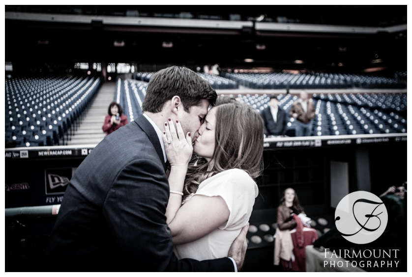 Couple kiss on field at Citizen's Bank Park