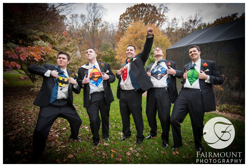 Groom and groomsmen wear superhero tshirts under tuxedos