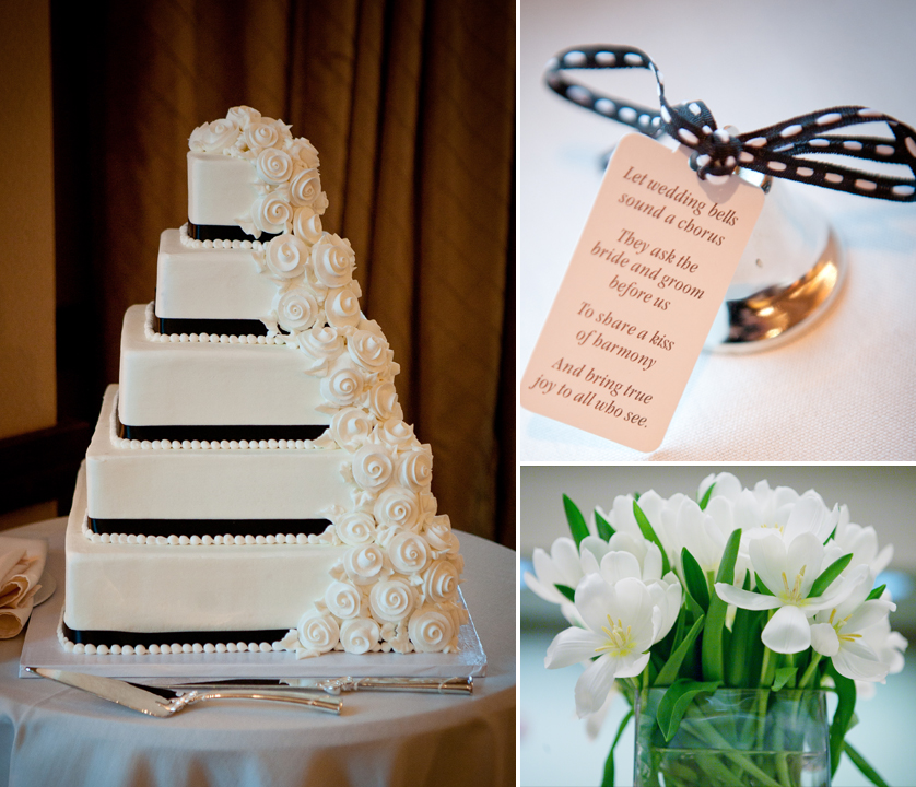 White wedding cake with black ribbons and white flowers