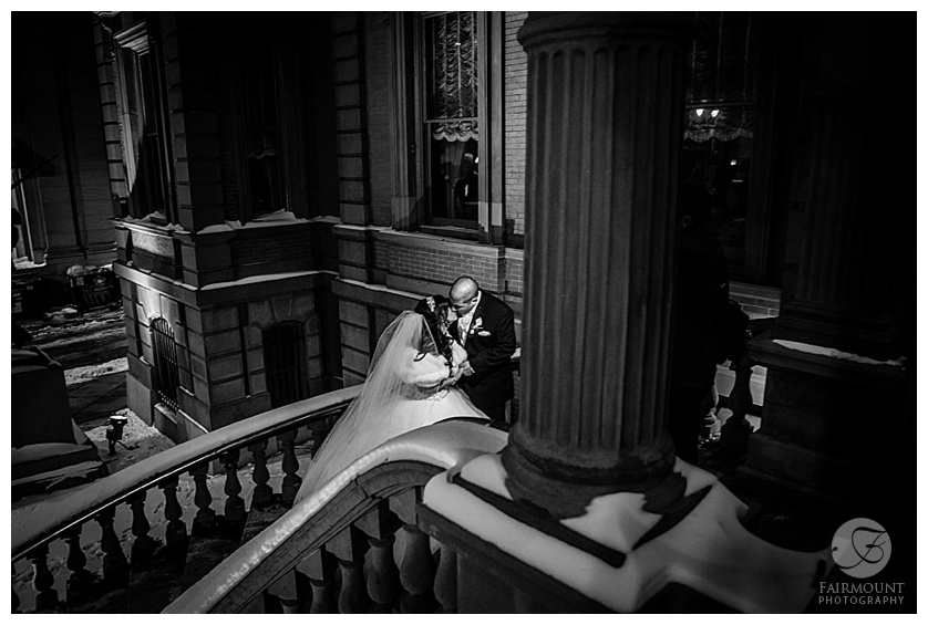 bride and groom on steps of the union league