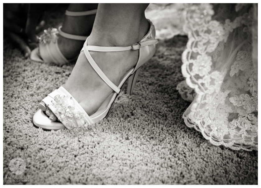 wedding gown lace and bride's shoes