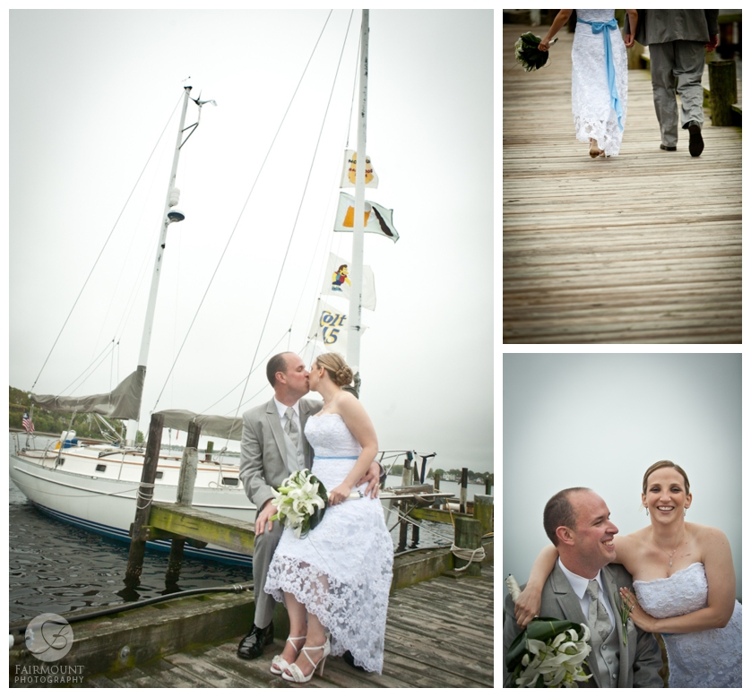 bride & groom kiss by sailboat
