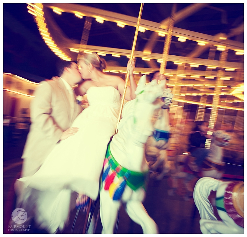 Bride and Groom on Carousel in Ocean City