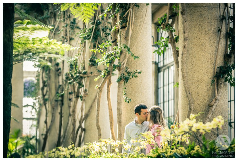 Couple kisses inside Longwood Gardens near Philadelphia, PA