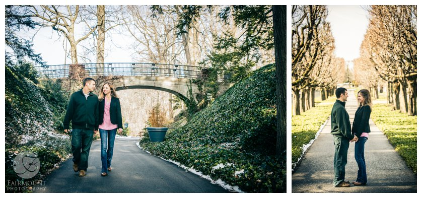 couple holding hands and walking down road in winter engagement photos