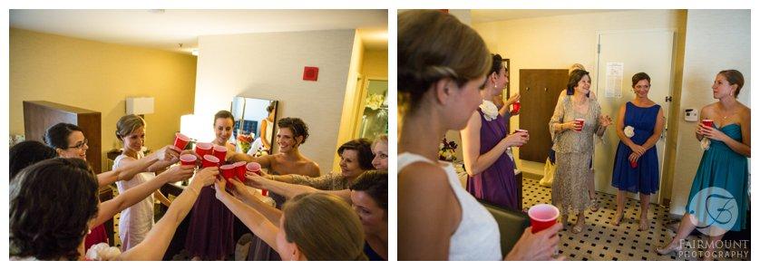 Hotel room toast at summer wedding in Philadelphia