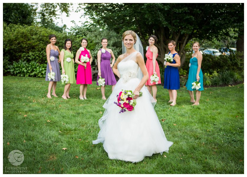 Bridesmaids in various colored dresses