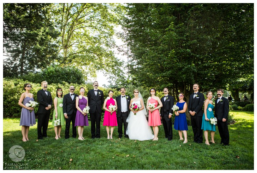 Bridal party wearing fake mustaches and goofy glasses