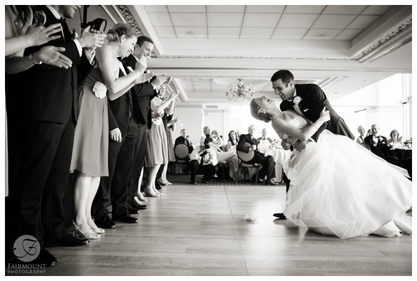 groom dips bride after first dance