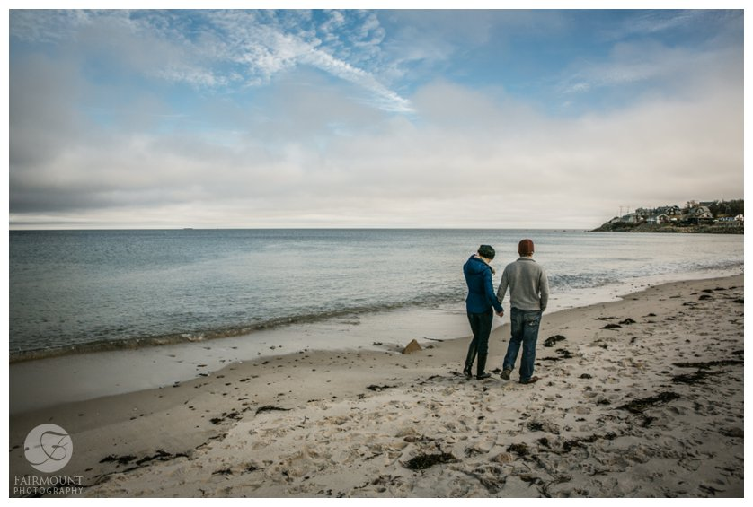 Couple walks along beach during Boston engagement photos