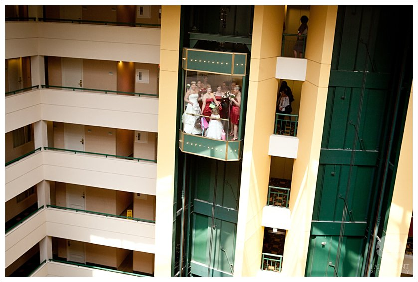 bridal party in glass elevator