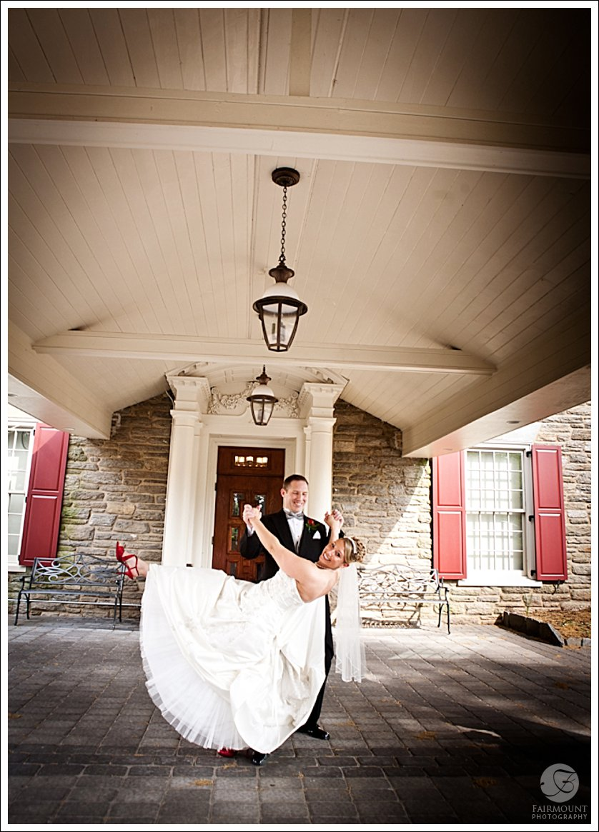 Bride and Groom portrait under portico at Meadowlands Country Club