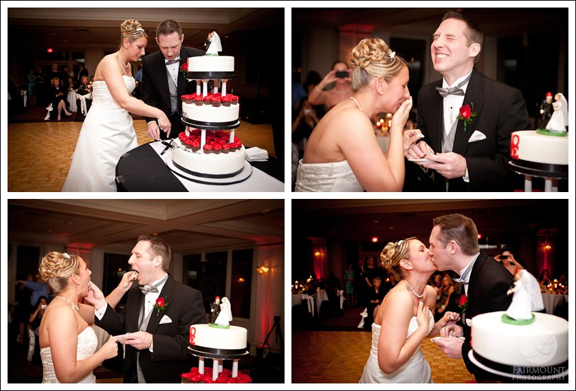 cutting black and red wedding cake with Love statue on top layer