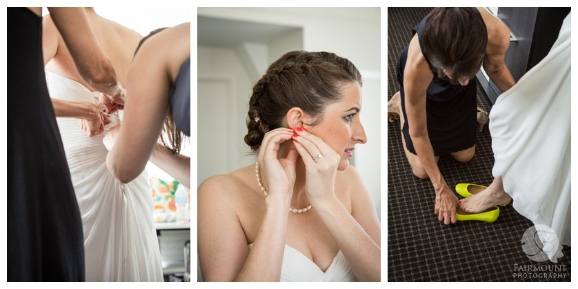 bride puts on pearl earrings, bridesmaid laces up wedding gown