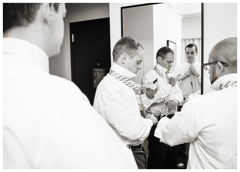 groomsmen put on ties