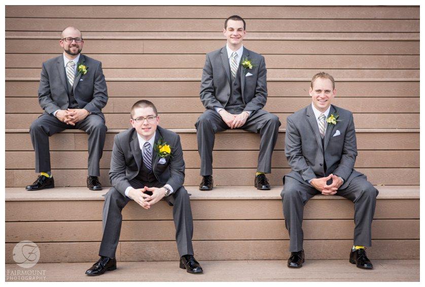groomsmen portrait on steps Race Street Pier