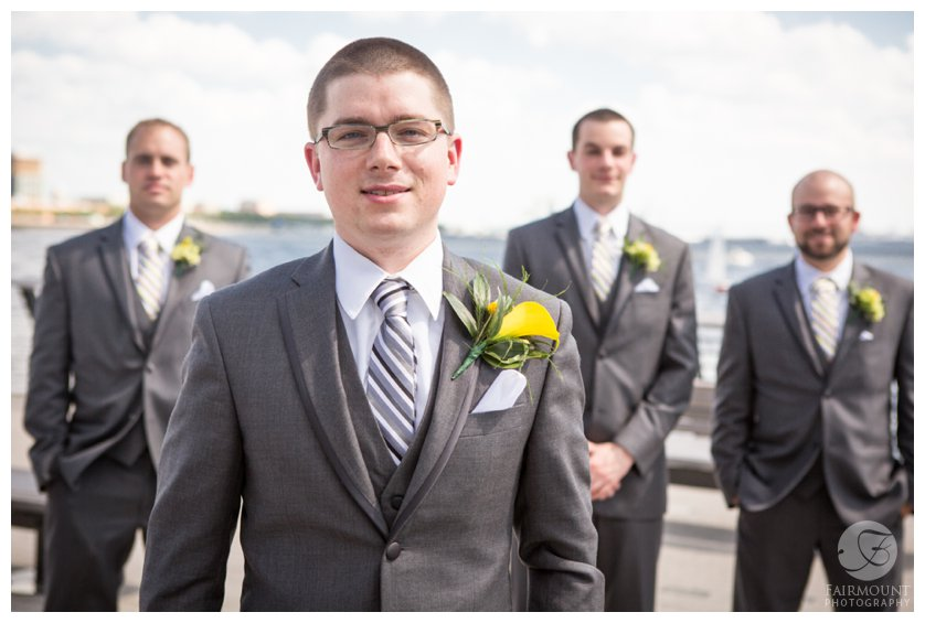 groom in gray suit with yellow boutonniere