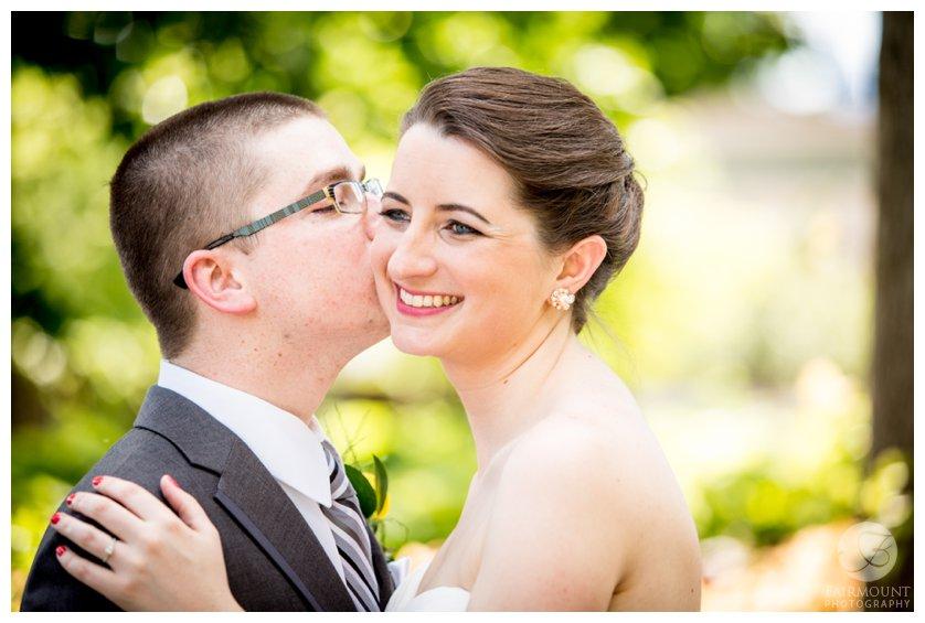 groom kisses bride on the cheek before June wedding in Philadelphia